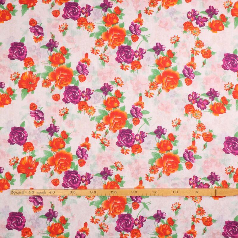 Blomster i lilla og orange nuancer - Bomuld/polyester -