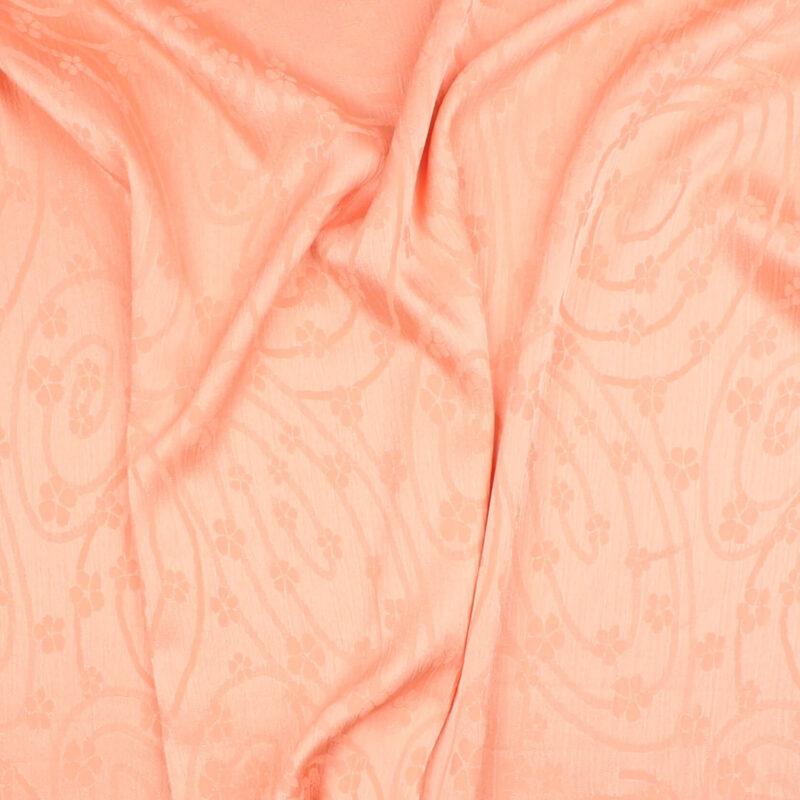 Lys laksefarvet m. mønster - Polyester m. let krøl -