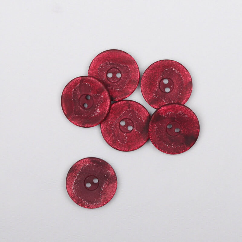 Røde nuancer og lidt glimmer, ø 23 mm -